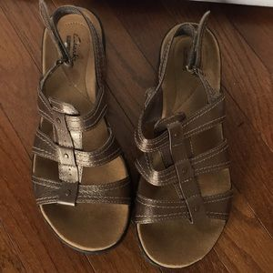 Clark's gold sandals in great condition